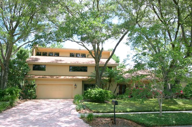 Tampa Pool Home for Sale on a golf course in Carrollwood